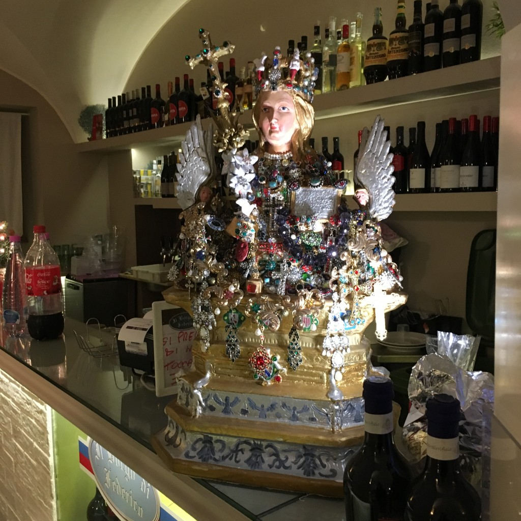 Santa Agata Statue on the counter of a local restaurant