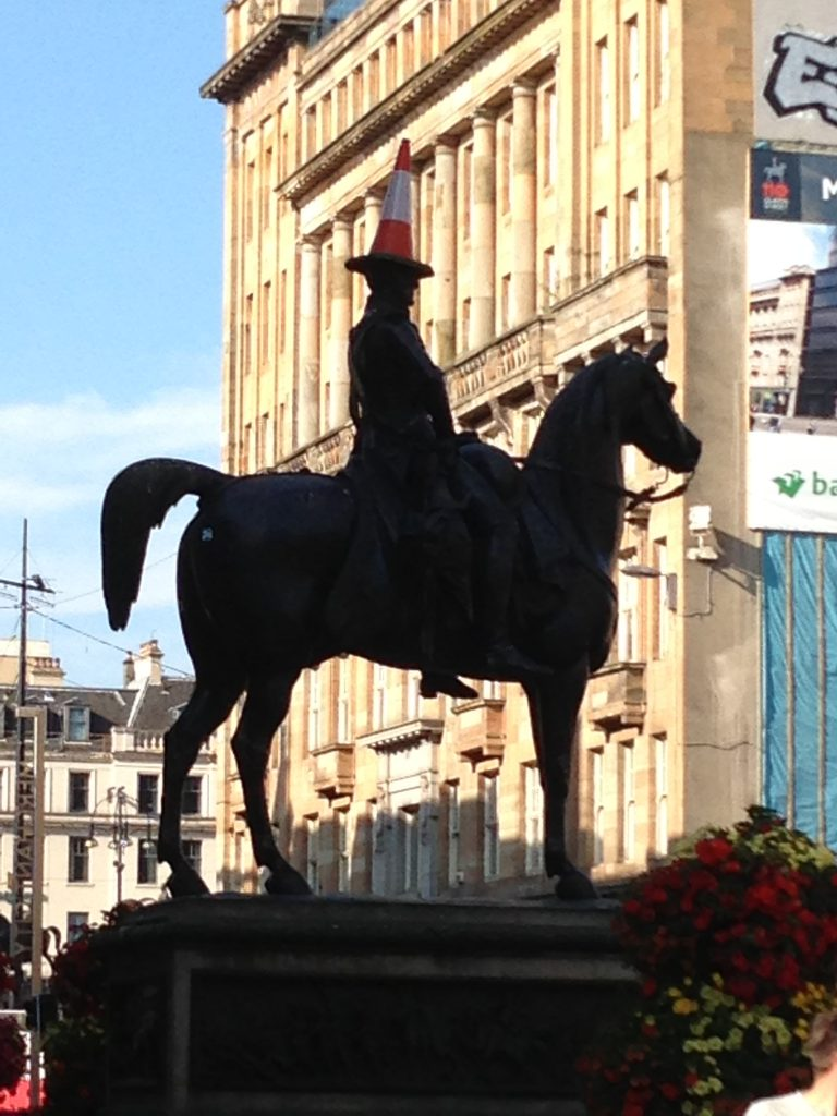 Glasgow 2013 - Why do all the statues have witches hats on their heads?